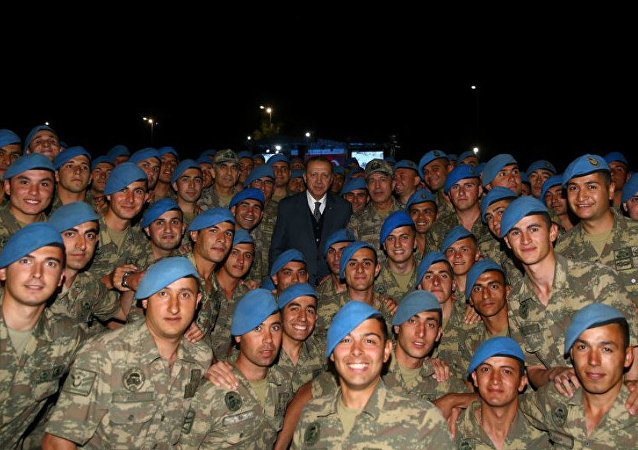 Turkish President Tayyip Erdogan poses with commandos following a fast-breaking iftar dinner at the 1. Commando Brigade in Kayseri, Turkey, June 8, 2017