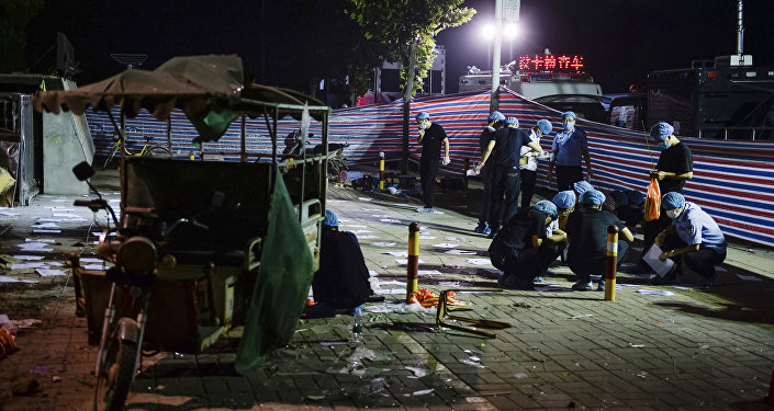 Investigators work early Friday, June 16, 2017, at the scene of an explosion outside a kindergarten in Fengxian County in eastern China's Jiangsu Province