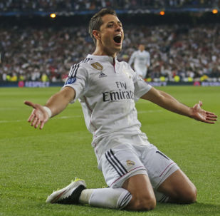 Real Madrid's Chicharito celebrates scoring his side's first goal during the second leg quarterfinal Champions League soccer match between Real Madrid and Atletico Madrid at Santiago Bernabeu stadium in Madrid, Spain