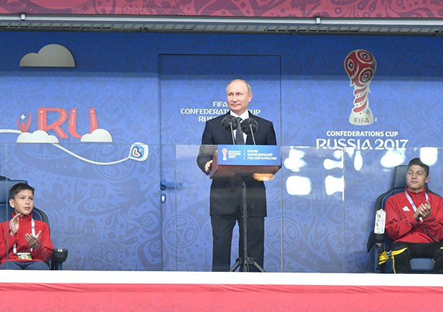 Russian President Vladimir Putin speaks at the St. Petersburg Arena ahead of the 2017 Confederations Cup opening match between the national teams of Russia and New Zealand