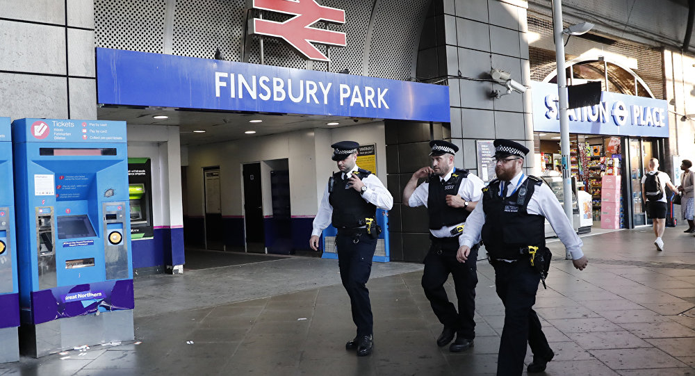 Police patrol outside Finsbury Park station in north London after a vehichle hit pedestrians