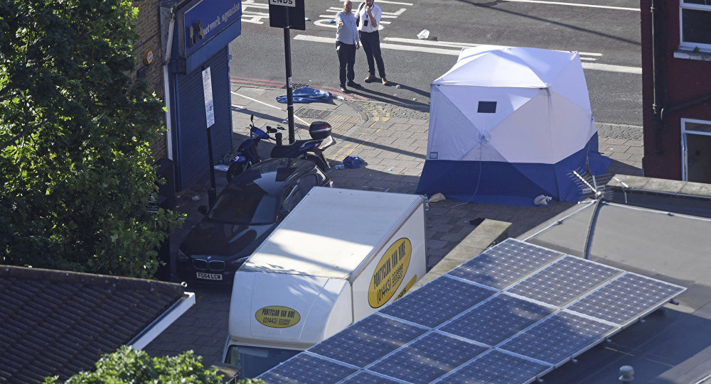 A forensic tent stands next to a van at Finsbury Park in north London after the vehicle struck pedestrians