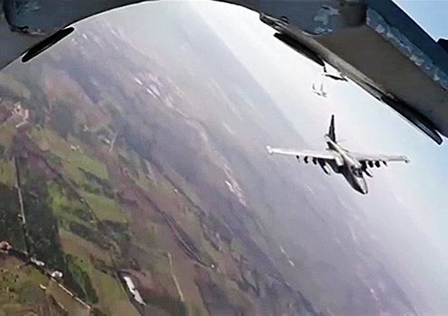 Russia's Su-25 aircraft take off from Hmeimim airbase escorted by Syria's MiG-29 fighter jets. (File)