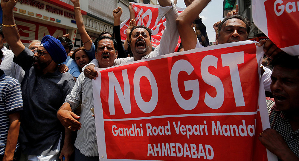 Traders shout slogans during a day-long strike against Goods and Services Tax (GST), set to be launched from July 1, in Ahmedabad, India, June 15, 2017