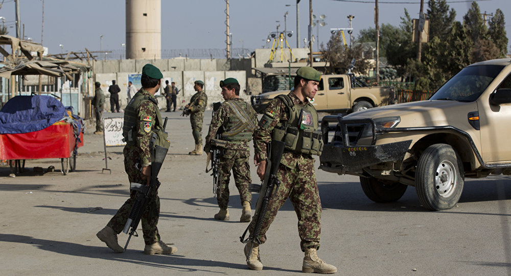 (File) Afghanistan's National Army soldiers guard, blocking the main road to the Bagram Airfield's main gate in Bagram, north of Kabul, Afghanistan, Saturday, Nov. 12, 2016