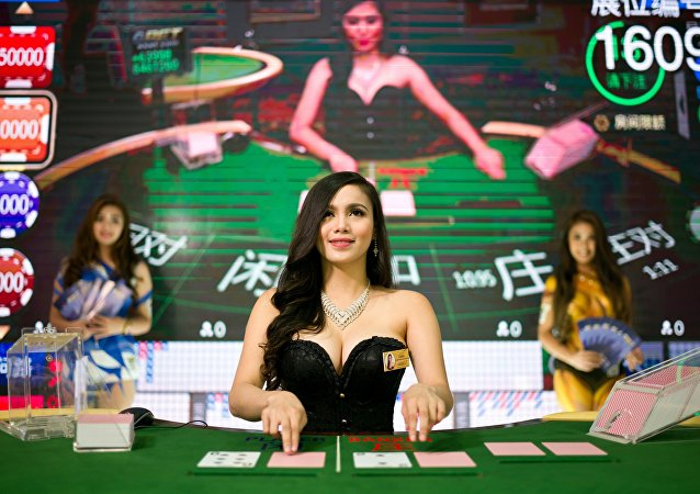 A baccarat dealer looks on during a demonstration at the Global Gaming Expo Asia held in Macau on May 17, 2016.