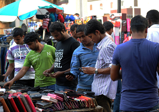 Indian workers browse at a market in the Saudi Arabian port city of Jeddah on August 4, 2016