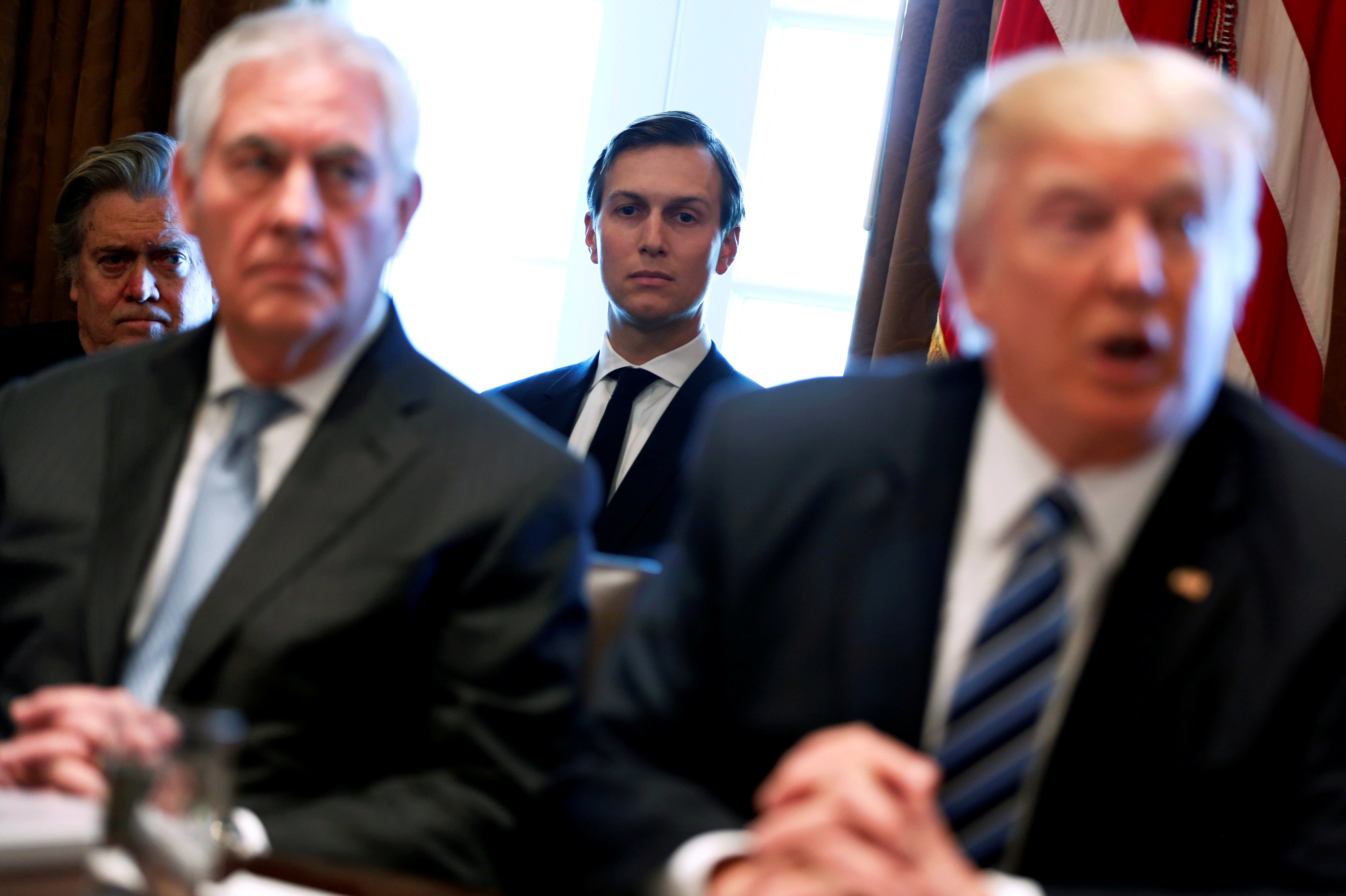 White House advisors Jared Kushner and Steve Bannon look on as U.S. President Donald Trump (R), flanked by Secretary of State Rex Tillerson (2nd L), holds a cabinet meeting at the White House in Washington, U.S.