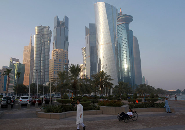 A man walks on the corniche in Doha, Qatar.