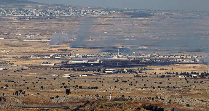 Israeli-occupied Golan Heights shows smoke billowing from the Syrian side of the border
