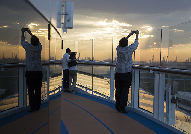 Passengers enjoy the sunset onboard Royal Caribbean's latest cruise ship the Ovation of the Seas ahead of its inaugural voyage at the International Cruise Terminal in northeastern China's Tianjin Municipality. (File)
