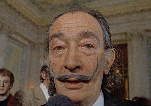 In this May 21, 1973 file photo, Spanish surrealist painter Salvador Dali, presents his first Chrono-Hologram in Paris, France.
