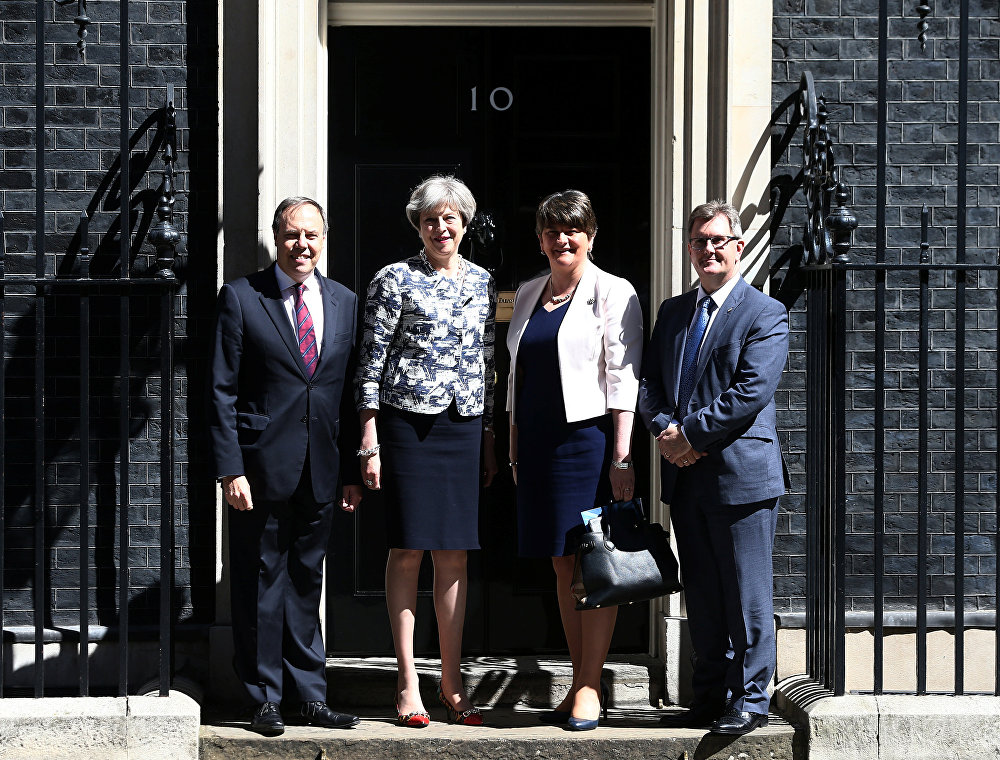 Britain's Prime Minister, Theresa May, poses for a photograph with Democratic Unionist Party (DUP) Leader Arlene Foster, Deputy Leader Nigel Dodds, and Chief Whip Jeffrey Donaldson, outside 10 Downing Street, in central London, Britain June 26, 2017.