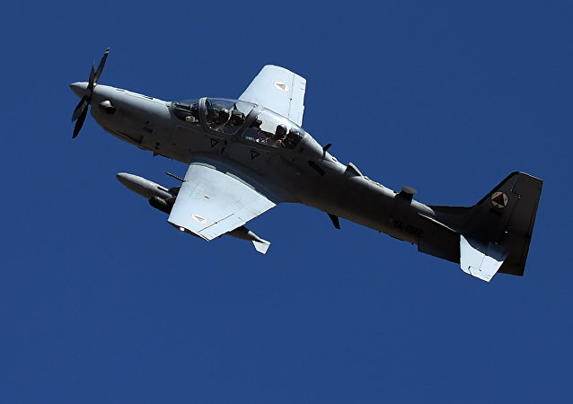 In this photograph taken on October 18, 2016, an Afghan Air Force Embraer A-29 Super Tucano aircraft flies during an airstrike training mission on the outskirts of Logar province