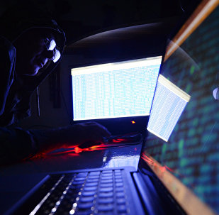 A man behind a laptop.