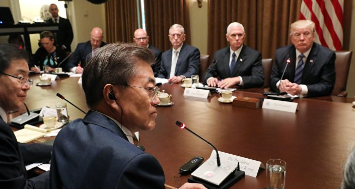 U.S. President Donald Trump (R) and South Korean President Moon Jae-in (4thL) meet with their delegations in the Cabinet Room of the White House in Washington, U.S., June 30, 2017