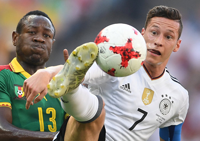 From left: Cameroon's Christian Bassogog and Germany's Julian Draxler during the 2017 FIFA Confederations Cup match between Germany and Cameroon
