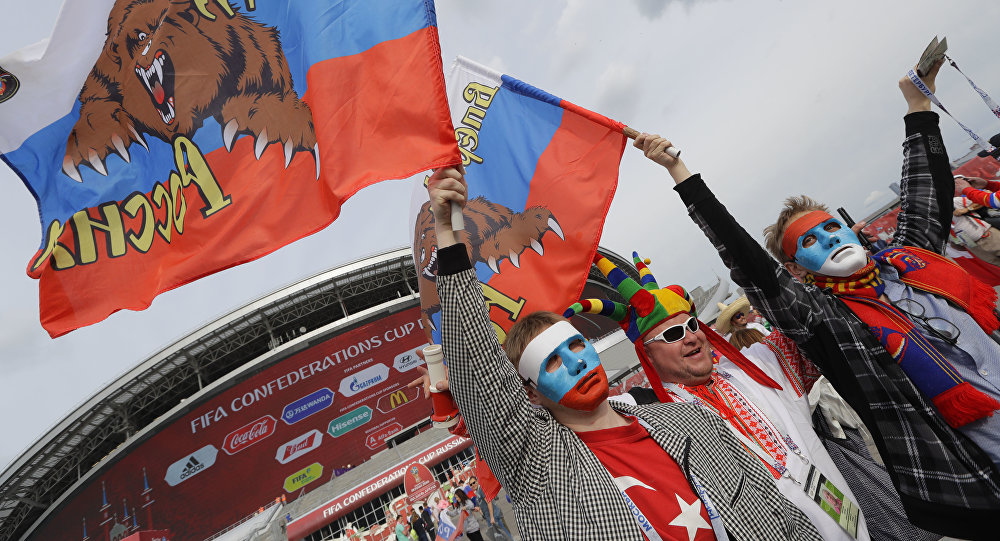 Russian supporter hold flags prior to the Confederations Cup, Group A soccer match between Mexico and Russia, at the Kazan Arena, Russia, Saturday, June 24, 2017.
