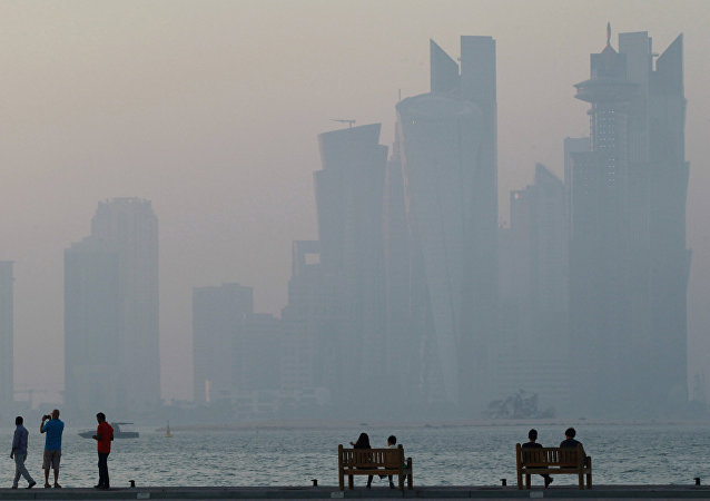 People sit on the corniche in Doha, Qatar, June 15, 2017.