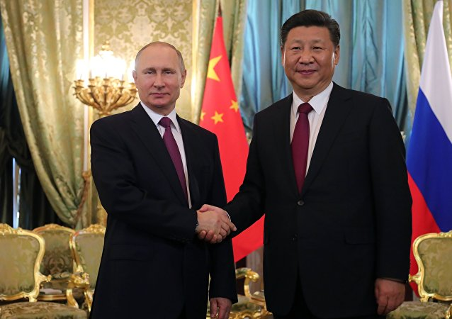 July 4, 2017. From left: Russian President Vladimir Putin meets with People's Republic of China President Xi Jinping in Moscow.