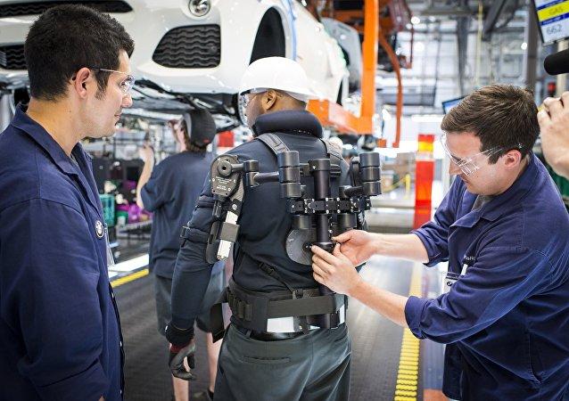 Factory worker in an exoskeleton