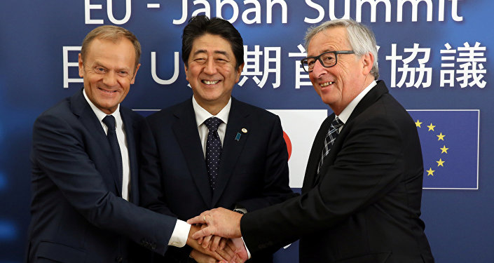 Japan's Prime Minister Shinzo Abe (C) is welcomed by European Council President Donald Tusk (L) and European Commission President Jean-Claude Juncker at the start of a European Union-Japan summit in Brussels, Belgium July 6, 2017.