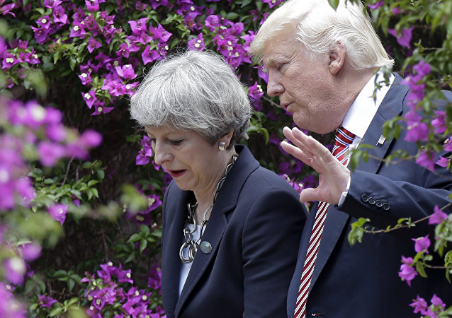 US President Donald Trump, right, talks with British Prime Minister Theresa May in Taormina, Italy, Friday, May 26, 2017.