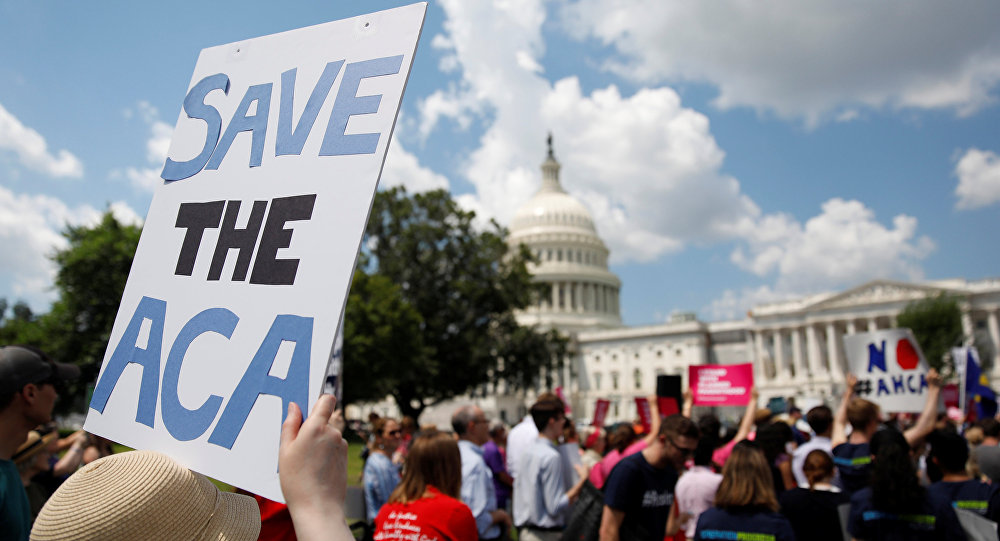Protestors gather during a demonstration against the Republican repeal of the Affordable Care Act, outside the U.S. Capitol in Washington, U.S., June 21, 2017