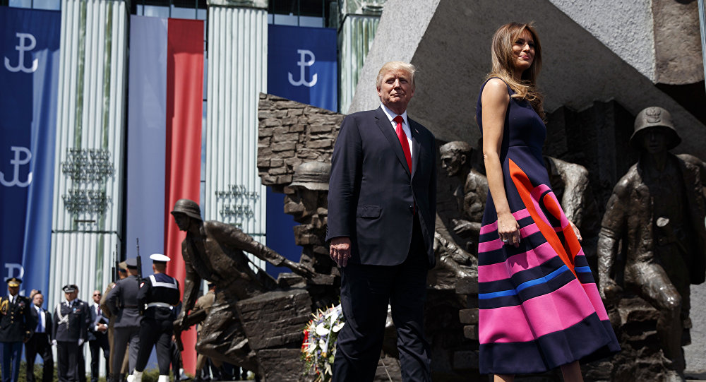 President Donald Trump walks with first lady Melania Trump to deliver a speech at Krasinski Square at the Royal Castle, Thursday, July 6, 2017, in Warsaw