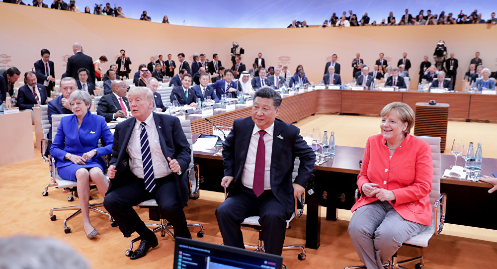 (L-R) US President Donald Trump, China's President Xi Jinping, German Chancellor Angela Merkel, Argentinia's President Mauricio Macri and Australia's Prime Minister Malcolm Turnbull turn around for photographers at the start of the first working sessionthe G20 summit in Hamburg, Germany, July 7, 2017