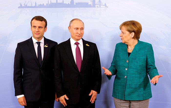 German Chancellor Angela Merkel, Russian President Vladimir Putin and French President Emmanuel Macron meet during the G20 leaders summit in Hamburg, Germany July 8, 2017