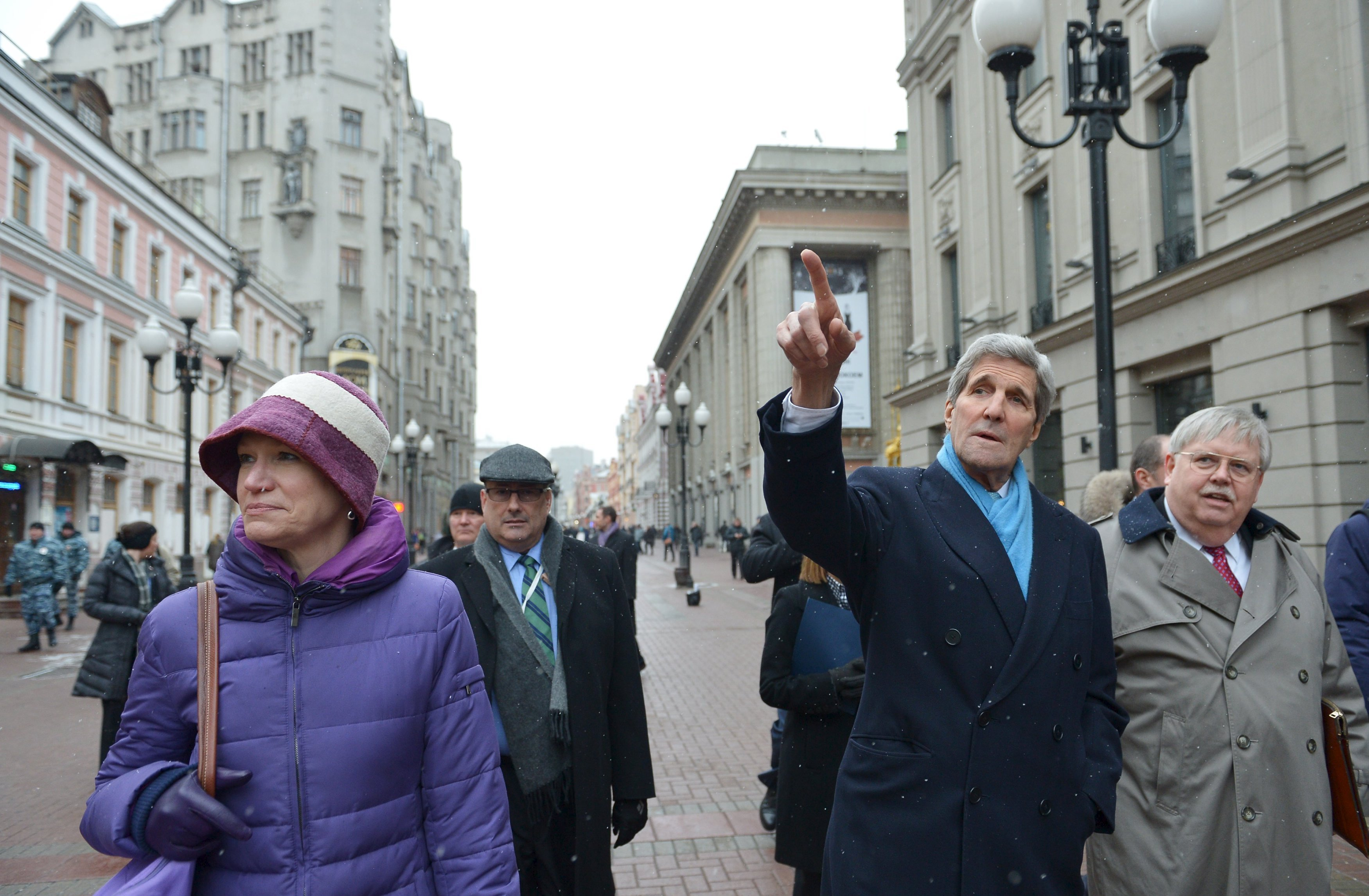 U.S. Secretary of State John Kerry (C) walks on Arbat Street while souvenir shopping with Celeste Wallander of the National Security Council (L) and U.S. Ambassador to Russia John Tefft (R) in Moscow on December 15, 2015