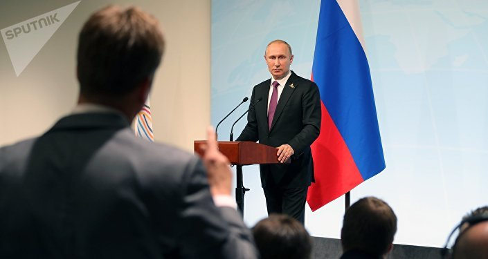 Russian President Vladimir Putin answers journalists' questions during a news conference summing up the results of the G20 summit in Hamburg