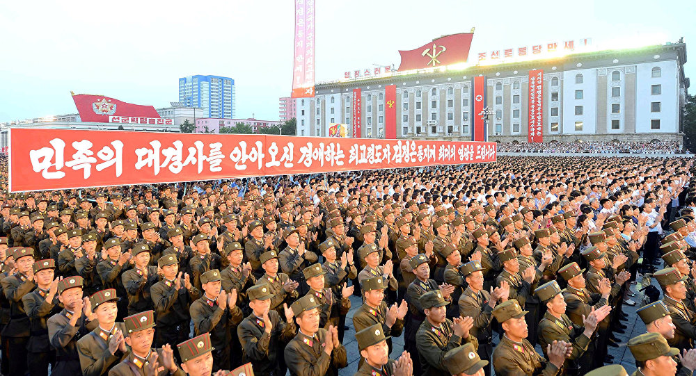 Army personnel and people gather at Kim Il Sung Square in Pyongyang July 6, 2017 to celebrate the successful test-launch of intercontinental ballistic rocket Hwasong-14. in this photo released by North Korea's Korean Central News Agency (KCNA) in Pyongyang July 7, 2017
