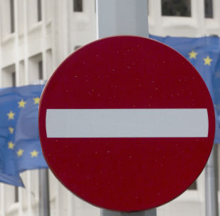 EU flags flap in the wind behind a no entry traffic sign in front of EU headquarters in Brussels.