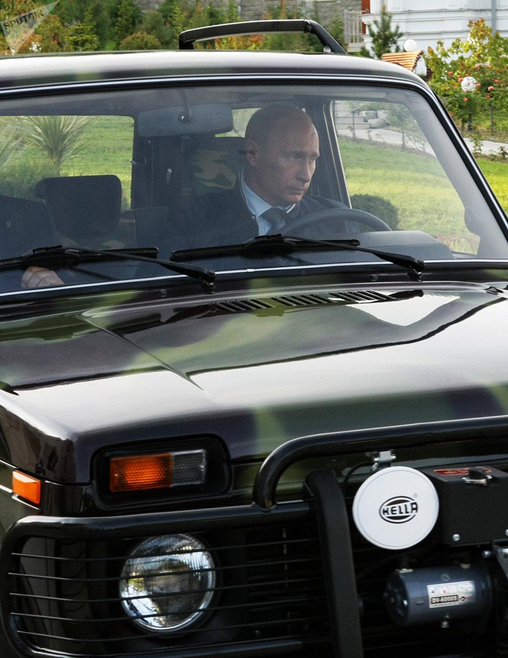 Vladimir Putin driving a Niva SUV in Sochi