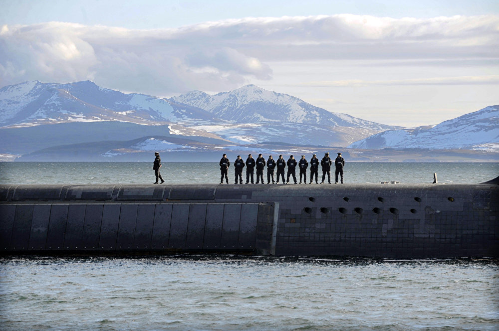British Navy personnel stand atop the Trident Nuclear Submarine, HMS Victorious, on patrol off the west coast of Scotland on April 4, 2013 before the visit of British Prime Minister David Cameron.