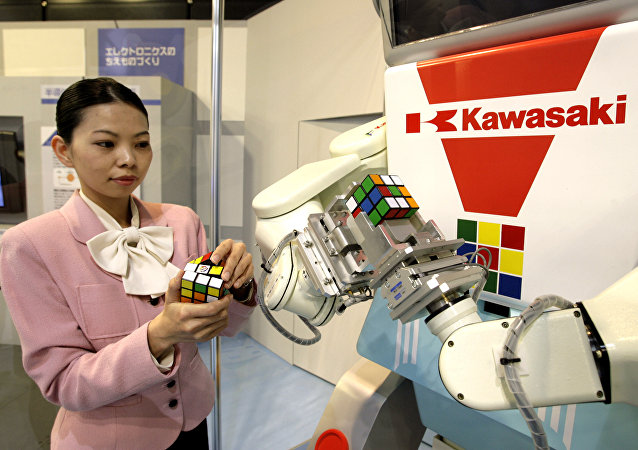 Japan's machinery maker Kawasaki Heavy Industries robot Cube-kun is seen solving a 3x3x3 Rubik's Cube during a demonstration in Tokyo