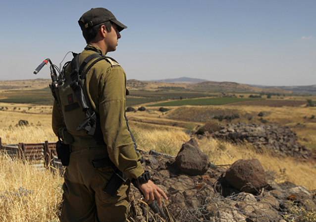 A Israeli soldier patrols near the border with Syria.