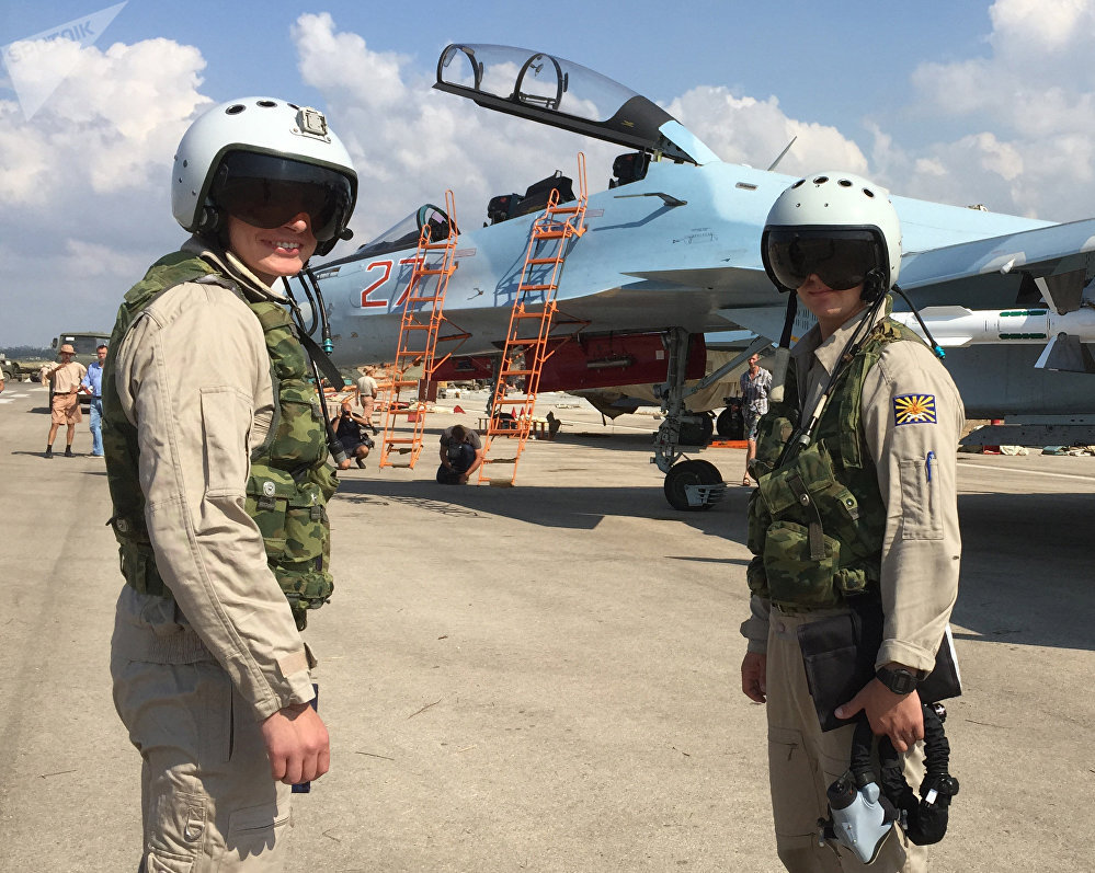 Russian pilots prepared to board the SU-30 attack plane to take off from the Hmeymim aerodrome in Syria. File photo