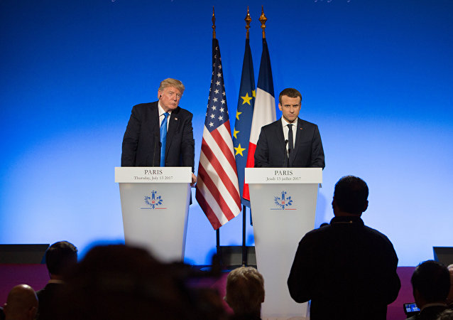 US President Donald Trump, left, and French President Emmanuel Macron during a news conference following a meeting in Paris