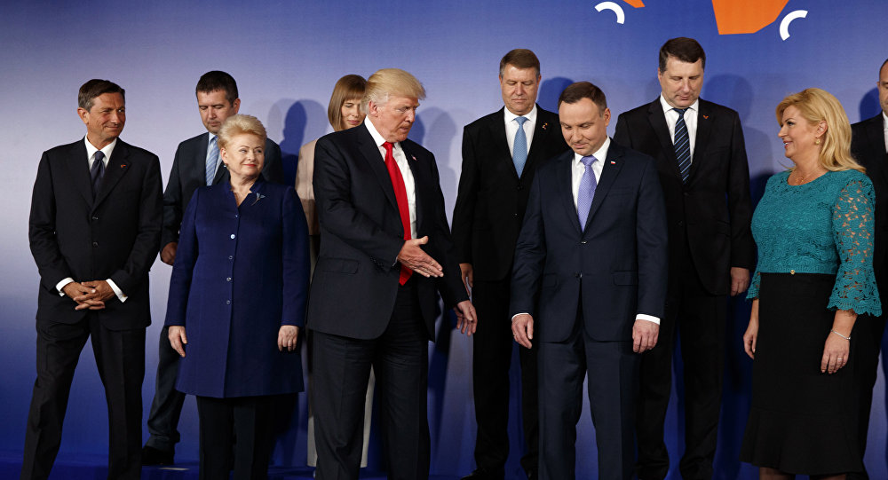 U.S President Donald Trump, center, participates in a group photo prior to the Three Seas Initiative transatlantic roundtable in the Great Assembly Hall of the Royal Castle, in Warsaw, Thursday July 6, 2017