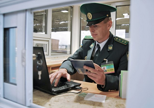 Ukrainian border officer at the international crossing point through the Ukrainian-Polish border Ugrinov-Dolgobichuv, located on the Ukrainian-Polish border in Poland near the village of Ugrinov in Sokalsky district, Lvov region