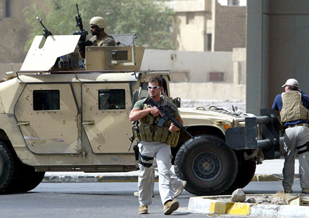 Contractors of the US private security firm Blackwater securing the site of a roadside bomb attack near the Iranian embassy in central Baghdad (File)