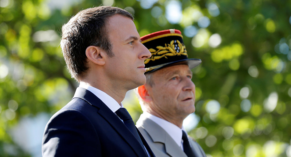 French President Emmanuel Macron (L) and Chief of the Defence Staff, French Army General Pierre de Villiers arrive for the annual Bastille Day military parade on the Champs-Elysees in Paris, France, July 14, 2017.