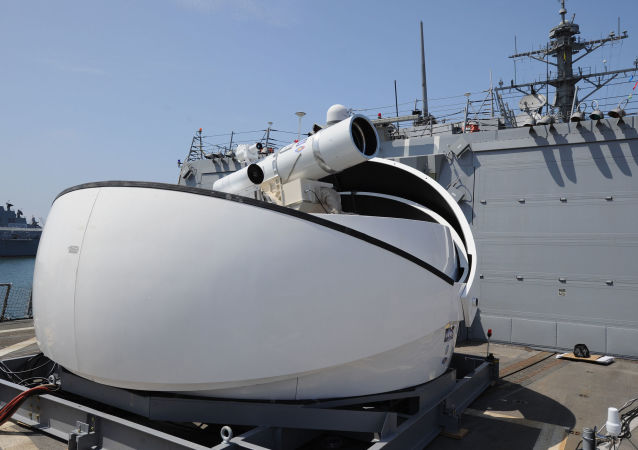 The Laser Weapon System (LaWS) temporarily installed aboard the guided-missile destroyer USS Dewey (DDG 105) in San Diego, Calif.