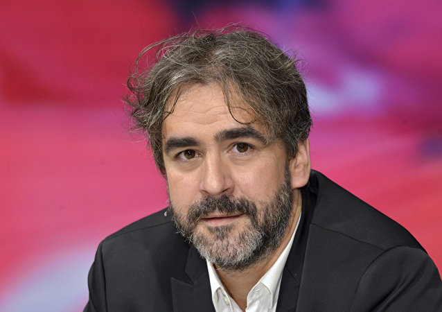 FILE - In this July 21, 2016 file photo German-Turkish journalist Deniz Yucel is pictured during a talkshow in Berlin, Germany.
