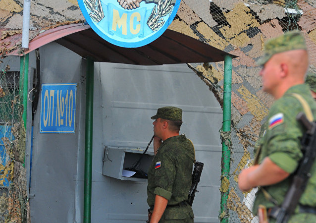 Russian peacekeepers at the checkpoint near the entrance to the town of Bender.