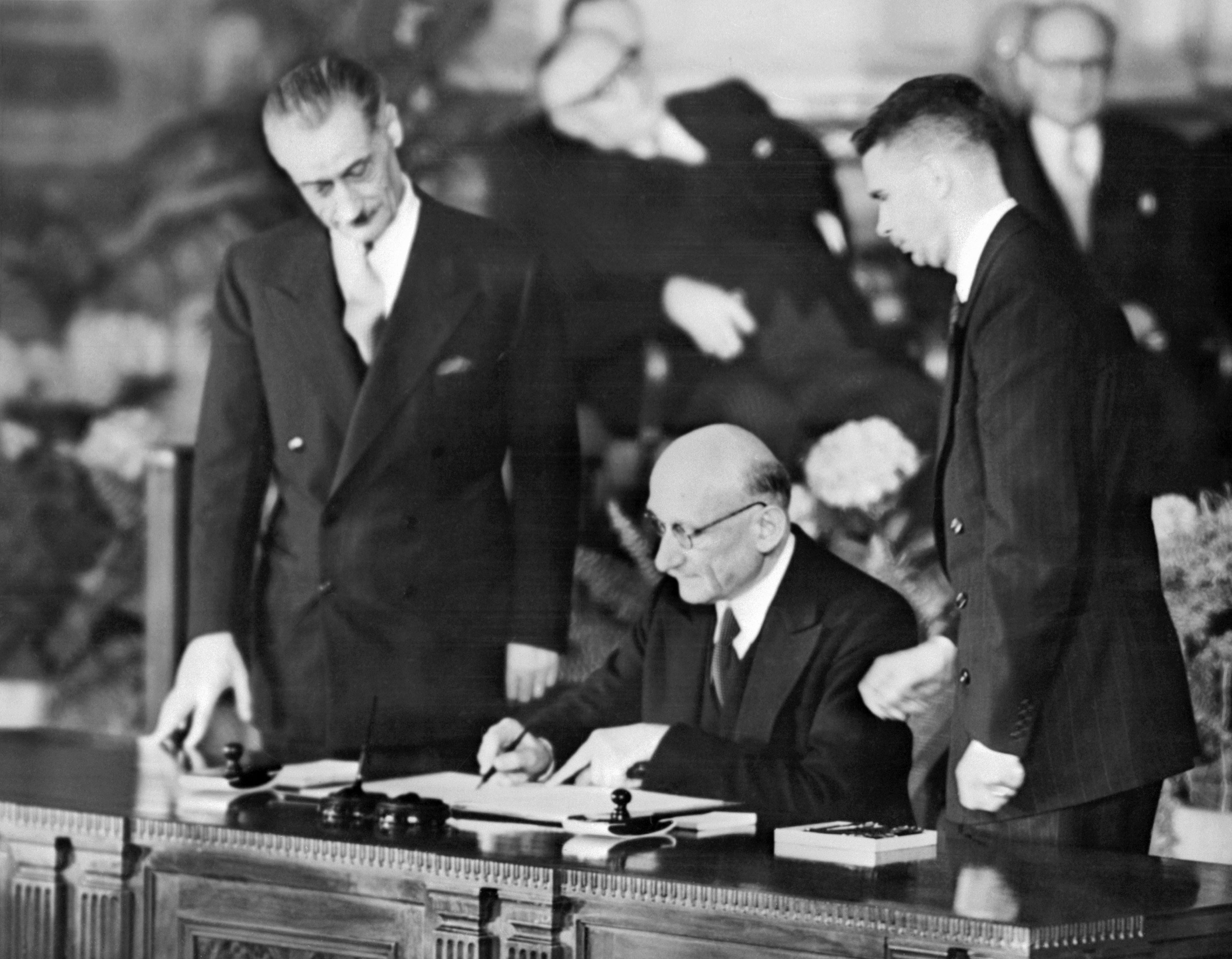 French foreign minister Robert Schuman signs 04 April 1949 the North Atlantic treaty during an official ceremony in Washington creating the North Atlantic Treaty Organization (NATO)