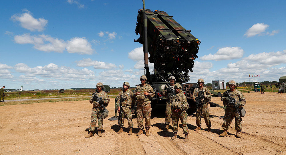 U.S. soldiers stand next to the long-range air defence system Patriot during Toburq Legacy 2017 air defence exercise in the military airfield near Siauliai, Lithuania, July 20, 2017